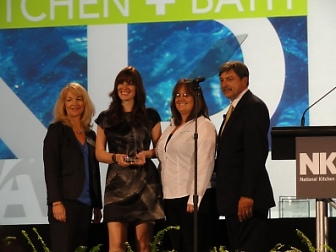 Linn's Kitchen's designer, Allison McCowan, pictured second from the left, received the first ever #1 in the nation award for budget friendly kitchen design. This design was presented on stage in Las Vegas during the 2011 Kitchen and Bath Business Tradeshow.
