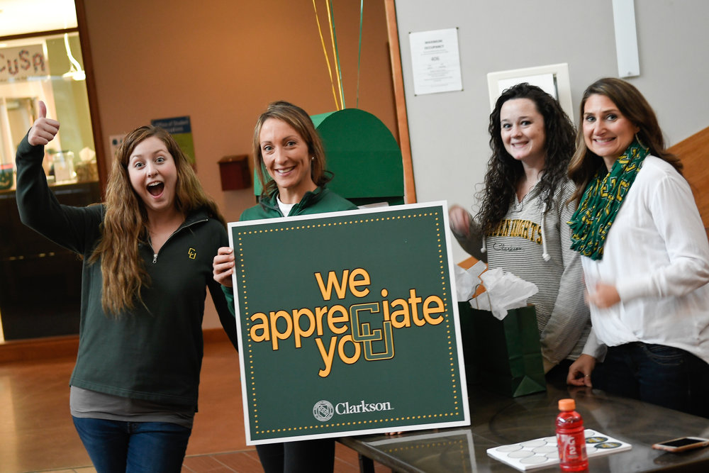 The CU Donor Relations team (Cara Valentine, Shannon Desrosiers, Danielle Mitchell and Jessica Nezezon) prepare for the first-ever thank-a-thon in the Student Center!