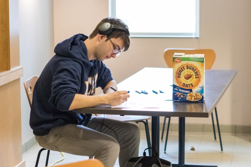 Scholarship recipient takes a break from studying (and snacking) before finals week to write an appreciation letter to his scholarship supporter!