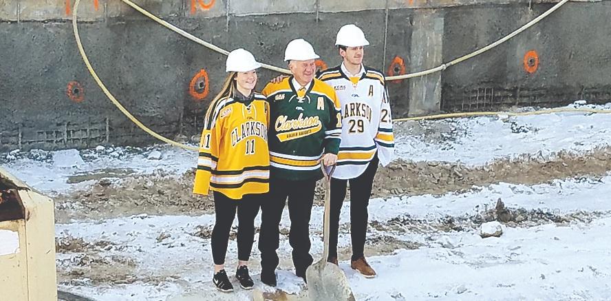 President Tony Collins, Women's Hockey Defenseman Ella Shelton and Men's Hockey Goaltender Jake Kielly are Diggin' the Cheel Construction!