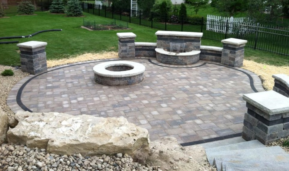 Madison WI patio with retaining wall, water feature and fireplace