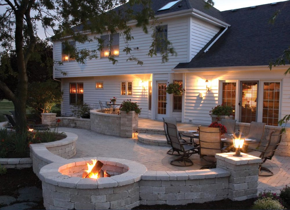 Outdoor living plans can include a wide array of amenities including fire pits, wall seating and paver patios