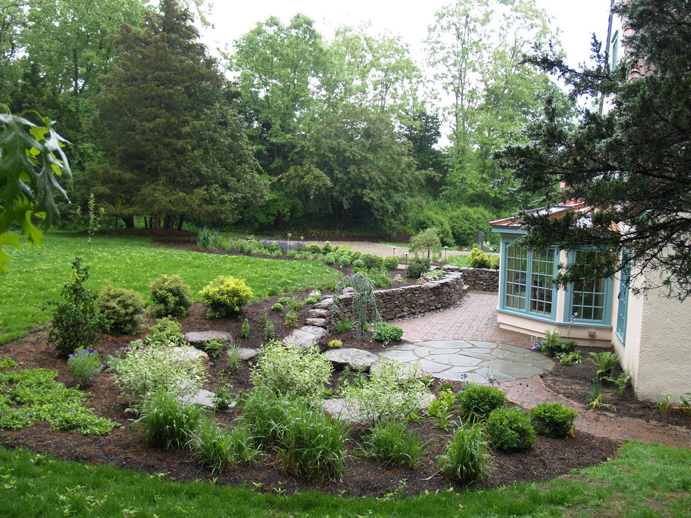A rain garden is great for rain water harvesting and can set up other landscape ideas such as patios, ponds and paver walkways