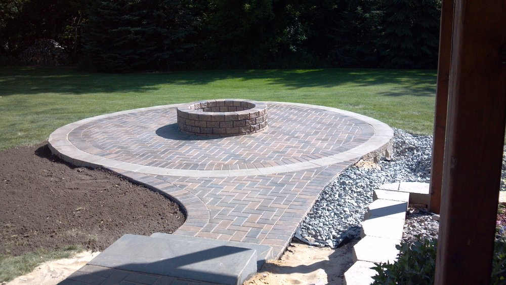 Landscaping done around your patio pavers in the fall will blossom early in the spring and have stronger root systems.