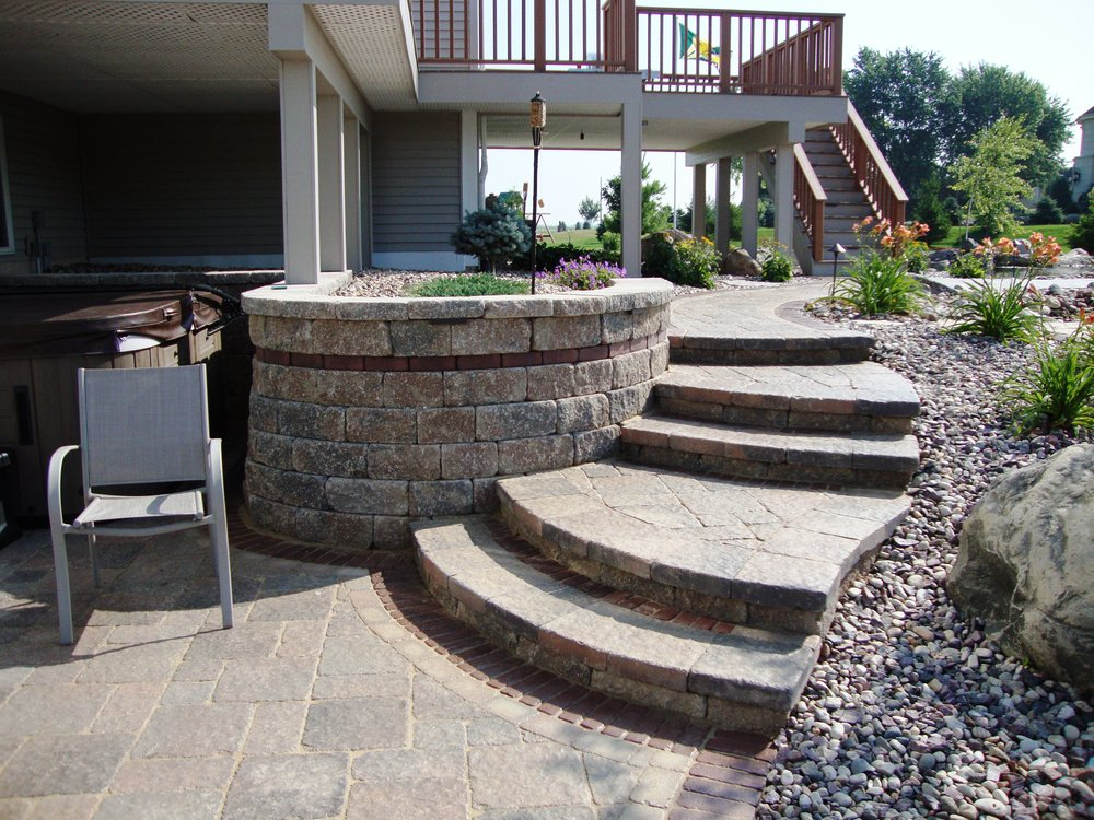 A retaining wall can help accent other aspects of your yard or create a planting bed