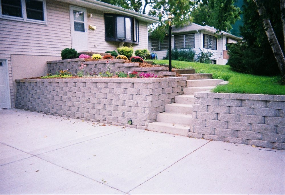 Retaining walls can help create stair cases highlighting the entry areas of your home