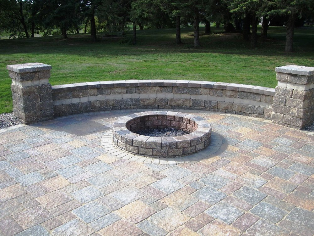Fire pits, built in benches, grills, outdoor ovens and other amenities can make outdoor living in Madison WI even more fun