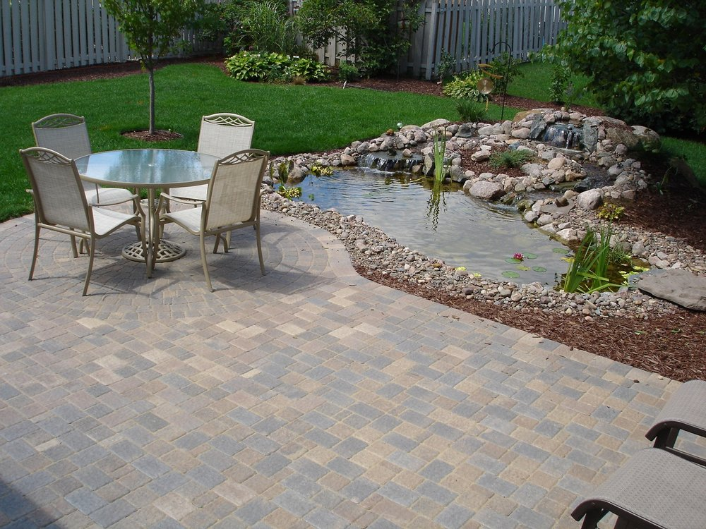 A complete landscape design can include ponds, a patio, fire pit, grading of yard and other great options for better living in Madison WI