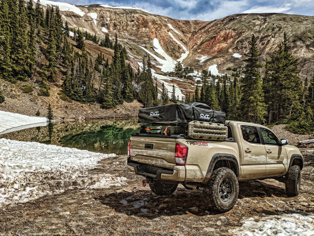 diamondback-hd-black-lifestyle-rear-angle-overlanding-lake.jpg