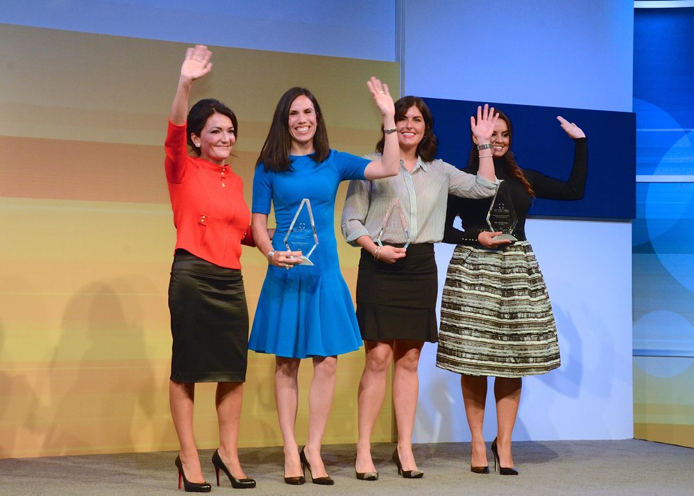 Nina Vaca  joins the three At The Table: Women in Business and Leadership winners onstage.  From left to right:  Nina Vaca, Dyan Medina Gibbens, Patricia Martinez, and Ana Julia Bermudez.