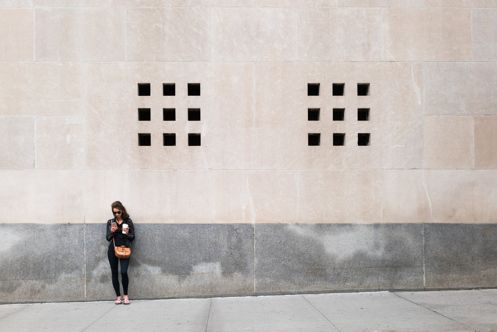 DeniseLaurinaitisNewYorkCityStreetPhotographersingleWomanWallLeatherJacketCigarette.jpg