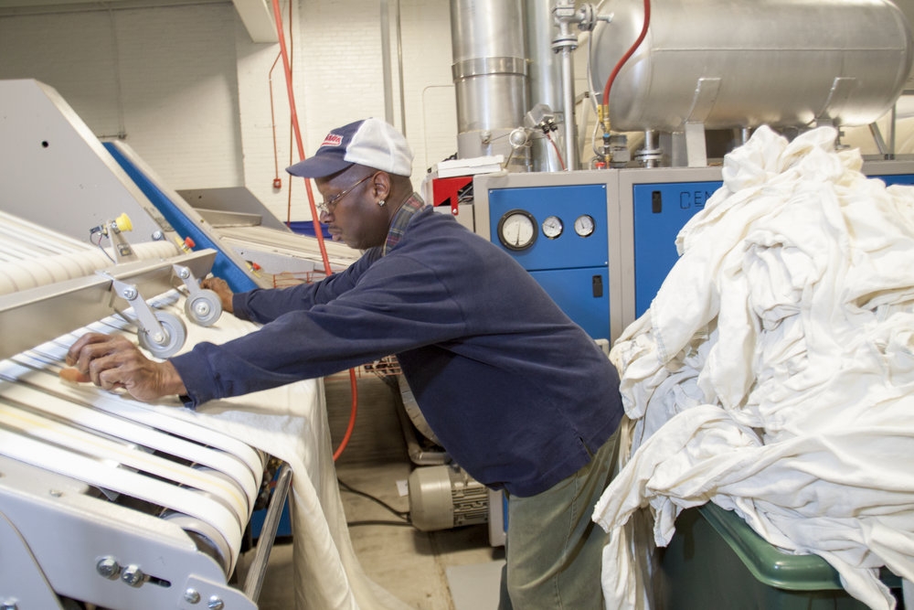 An employment program trains University Circle neighbors to work in Evergreen Laundry, one of three cooperatives that serve the main anchor institutions.