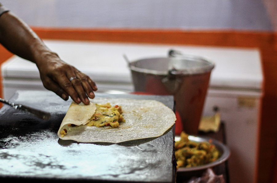 bigstock-Folding-Dosa-After-Adding-Pota-250425892.jpg