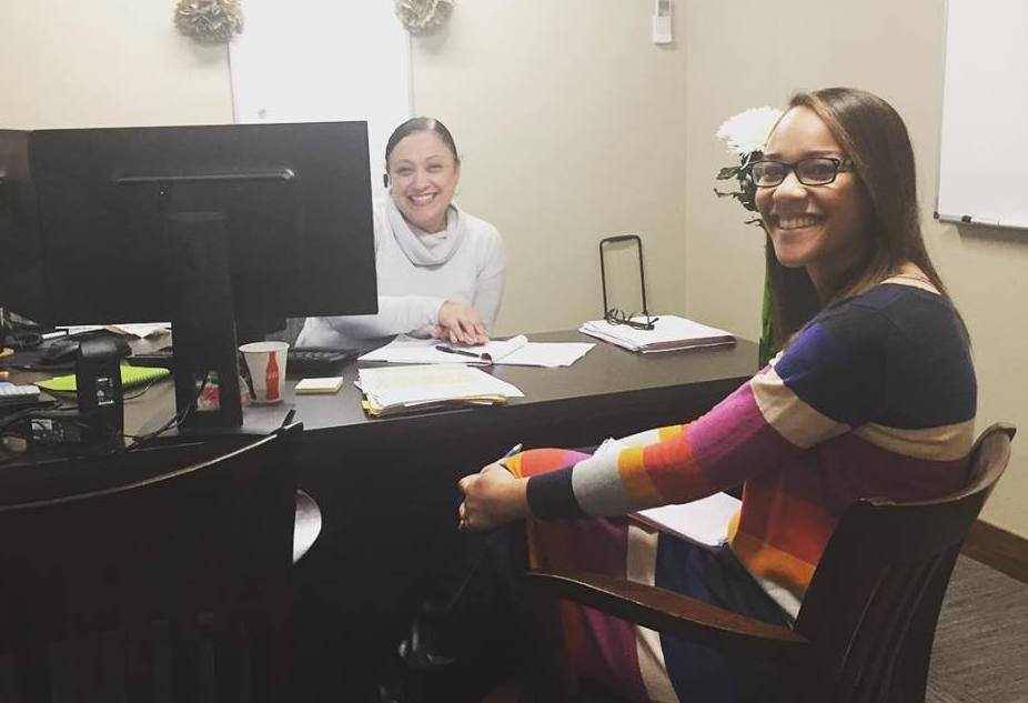 Contact Center Manager Susan meeting with Contact Center Lead Brielle.