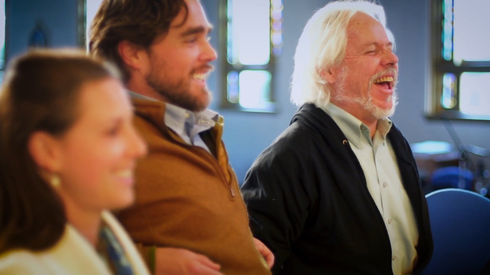 Ananda folks laughing during a sunday service.jpg