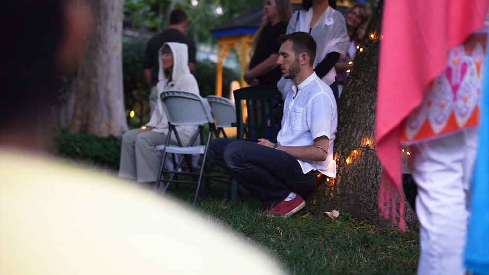 Bryan M meditating by tree.jpg