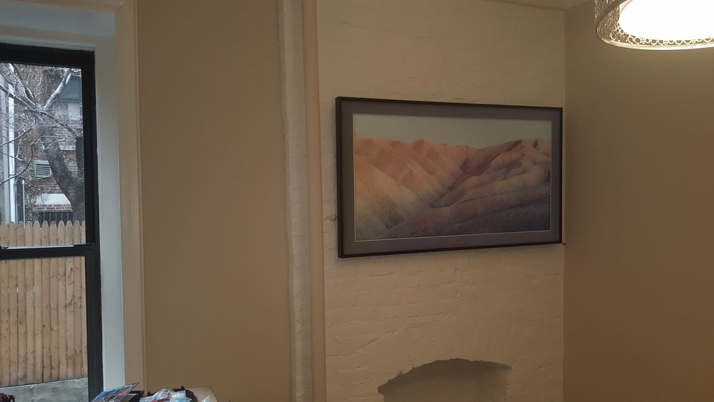 This is actually a Samsung frame with no wires visible, but it is art when it is off.