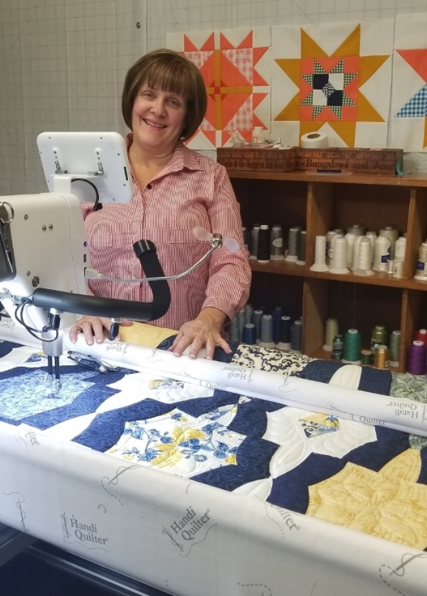 Quilt is on the Amara….thread stash and design wall behind me. Let's go QUILT!