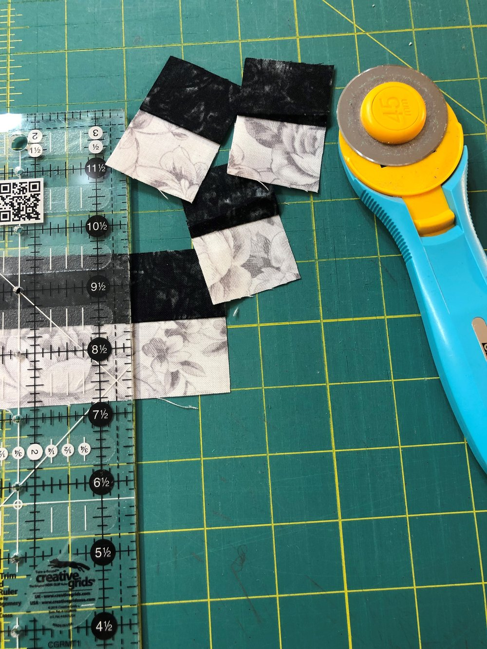 - You then take your pressed black and gray strips to your cutting board and cut 1 ½ small rectangles.