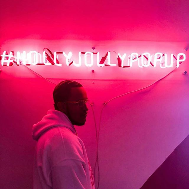 Dallas nights and neon lights 💥@idreamofprada snapped this at the #hollyjollypopup is open until 8pm tonight! Get your tickets and come on out!