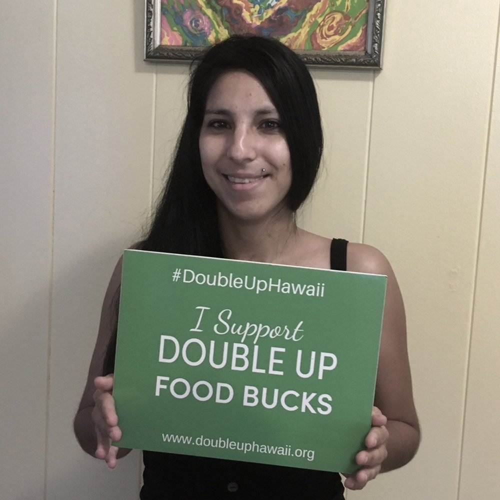 """""""Getting Double - Up would be an important step toward increasing my family's health and wellness. More produce is a great benefit.""""~Layna A., Aide for special needs individuals and SNAP farmers market shopper"""