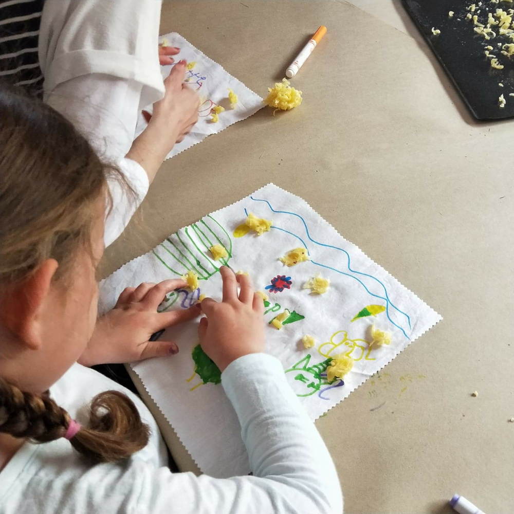 Make Your Own Beeswax Wrap - Kids learn the importance of reducing plastic while making and decorating their very own reusable food wrap.