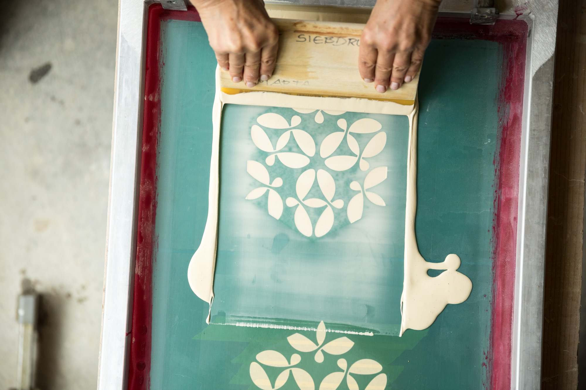 Sebastian's designs are applied to his mother's tiles through silk screening