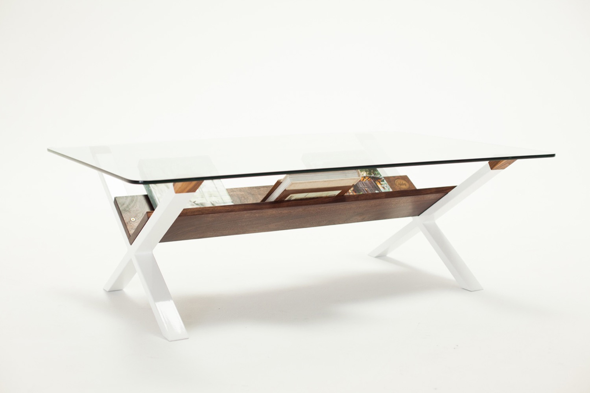 X Table in walnut by Sean Woolsey