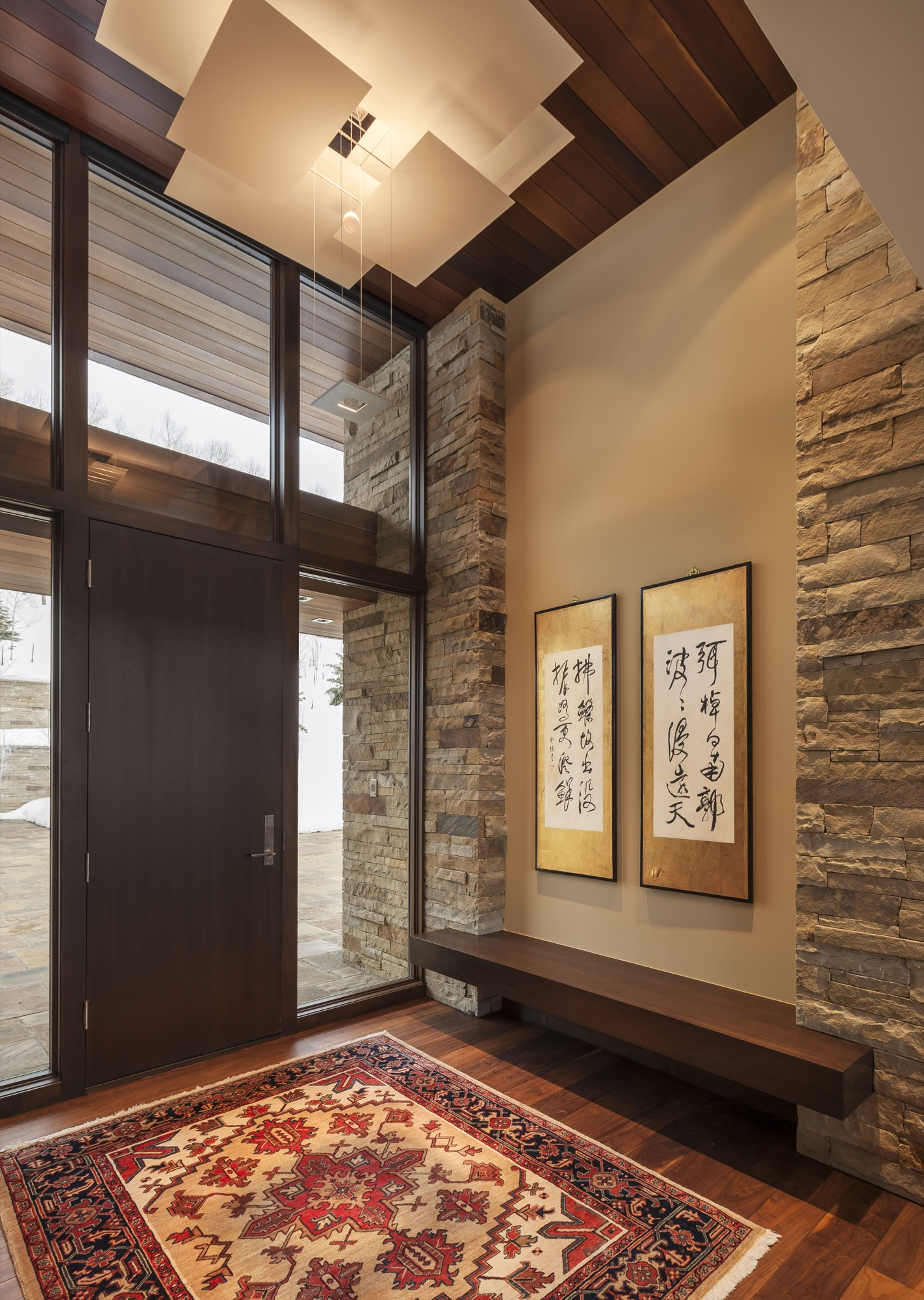 Indoor-outdoor flow: Every stone on the inside matches the color of its counterpart on the opposite side of the glass / Photo by Paul Crosby