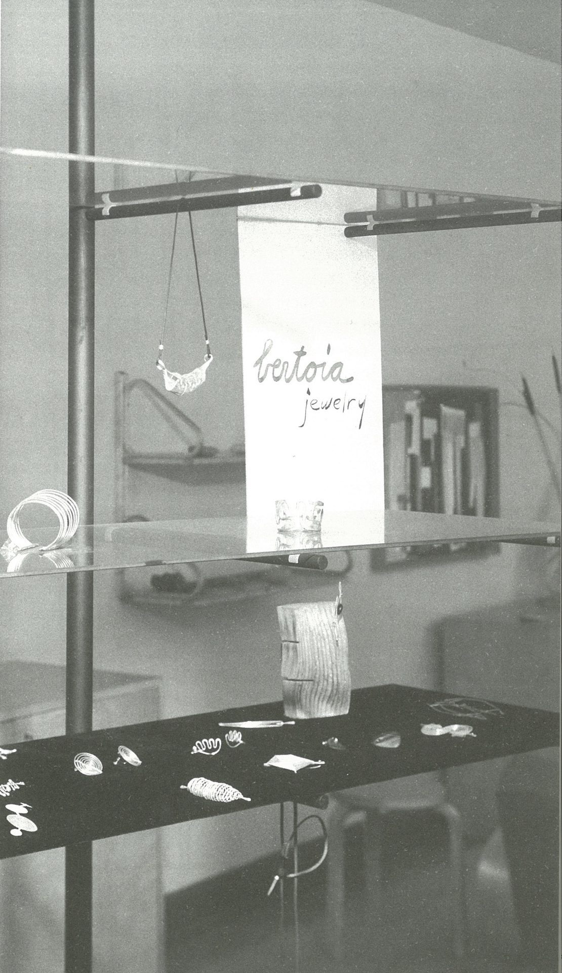 Making do: Harry Weese designed open shelving of floating glass and steel poles to display Bertoia jewelry