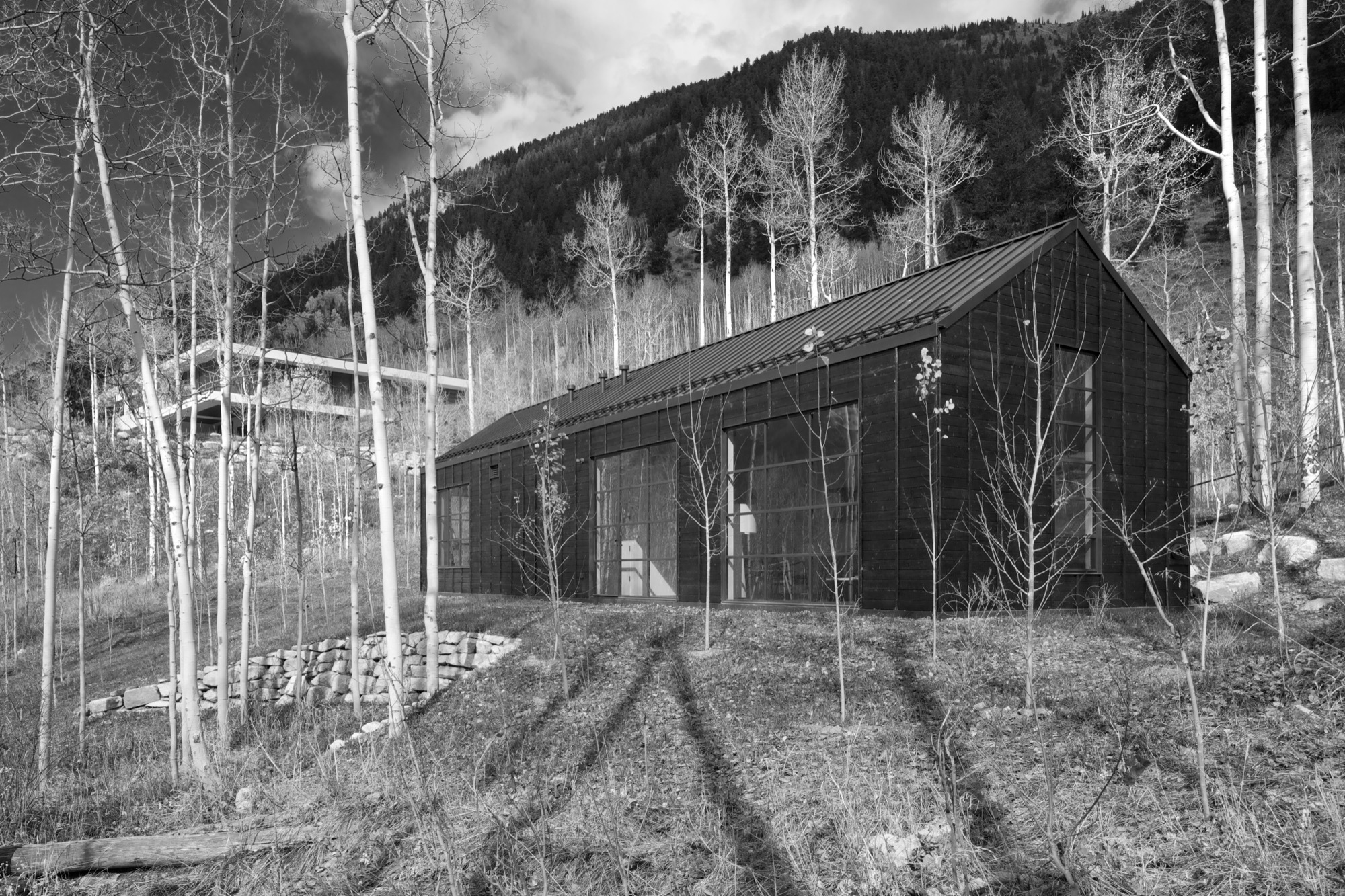 Cottage Black in nestled in the aspen grove below the main house / Photo by Greg Watts