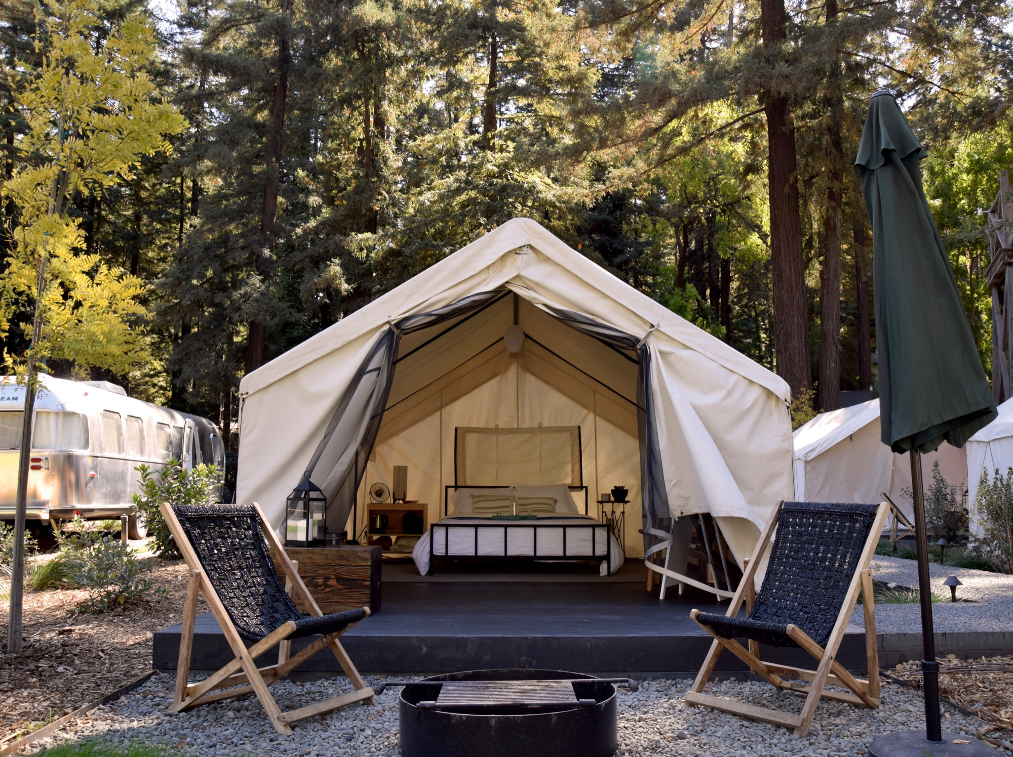 Outside each tent is a patio area outfitted with lounge chairs and a fire pit. At night, an electric blanket keeps things toasty / Photo by Emma Geiszler