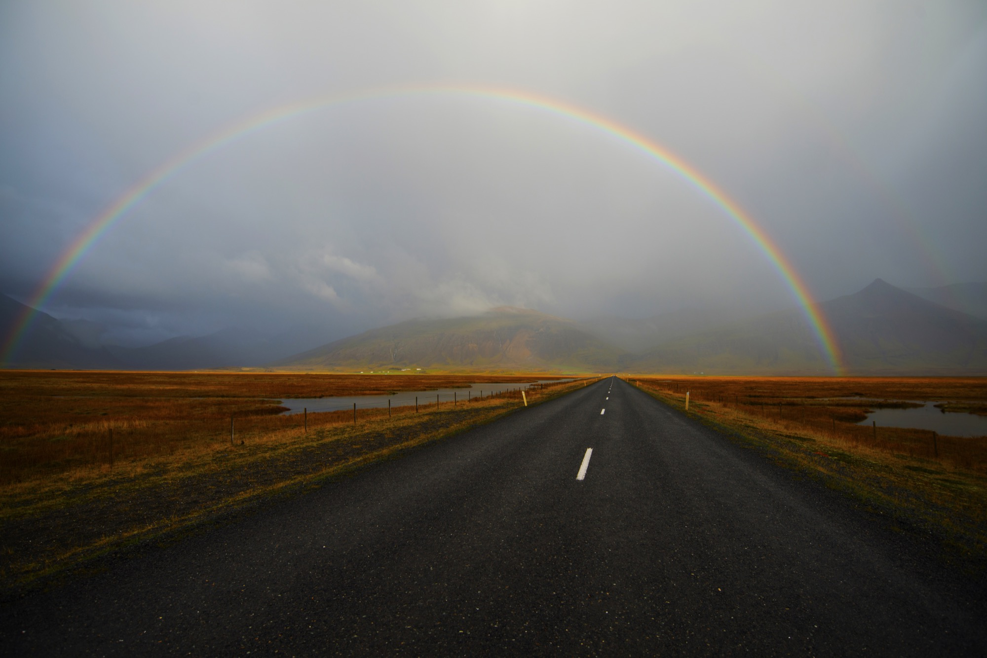 Rainbow over the road, Iceland / Photo by Joe Goldberg