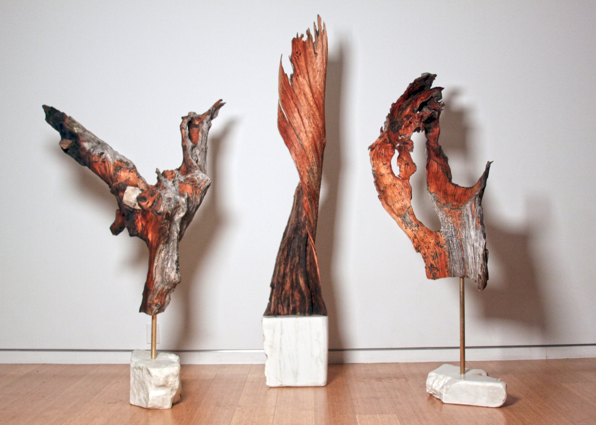 Alpenglo Sculpture series by MTN Lab—unique carved pine elements balanced with brass on marble bases.