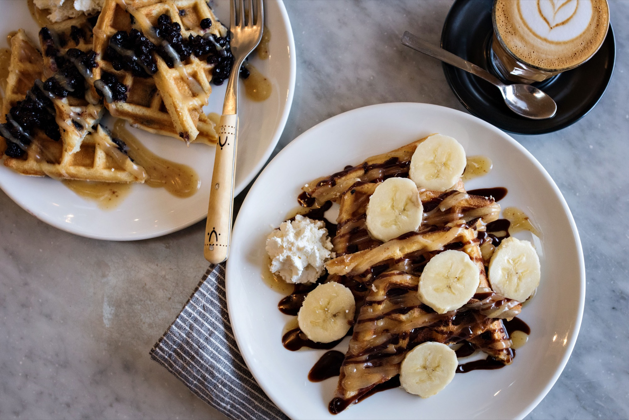 L: Blueberry Waffle with maple brown butter / R: Nutella Banana Waffle with maple brown butter / Photo by D'Ann McCormick Boal