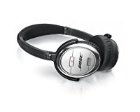 Noise Cancelling Headphones - At the very least, you might want to include earplugs when you fly. Occasional short flights aren't a big deal but if you're traveling a lot or changing time zones, you will need to keep up on your sleep if you want to enjoy yourself. These noise cancelling headphones do just that, and they also help deter talkative neighbors from starting conversations when you're not feeling social.