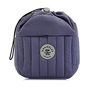 Crumpler Haven Camera Pouch - This padded pouch has 3 sections for camera gear so it stores my camera and 3 lenses perfectly. It also fits inside all of my other bags so I can turn any backpack, tote bag or duffel into a camera bag by putting this inside. When I'm traveling, I'm always switching bags depending on the activity so this is a perfect way to bring my camera without needing to bring dedicated camera bag.