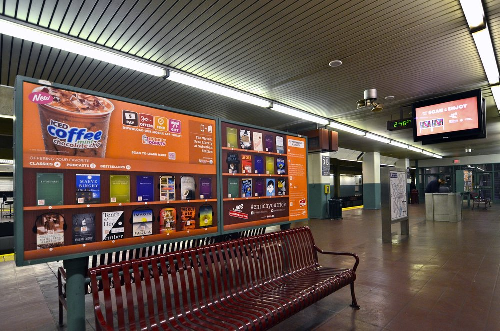 A coffee, a book, and a train ride. All in one. - Literally. What combination out there tops a book and a good cup of coffee? That's exactly what the Free Library of Philadelphia and Dunkin' Donuts aimed to bring to the daily transit riders in Philadelphia's Suburban Station.