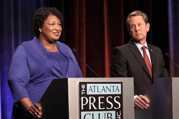 Stacey Abrams and Brian Kemp, pictured at a debate. Source, The New York Times.