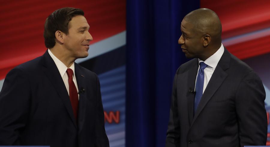 Ron DeSantis and Andrew Gillum, pictured at a debate. Source, Politico.