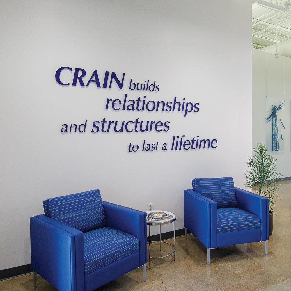 Crain Construction_Brand Identity Signage_Lobby Wall_Acrylic letters_MG_7923_small 2000 px.jpg
