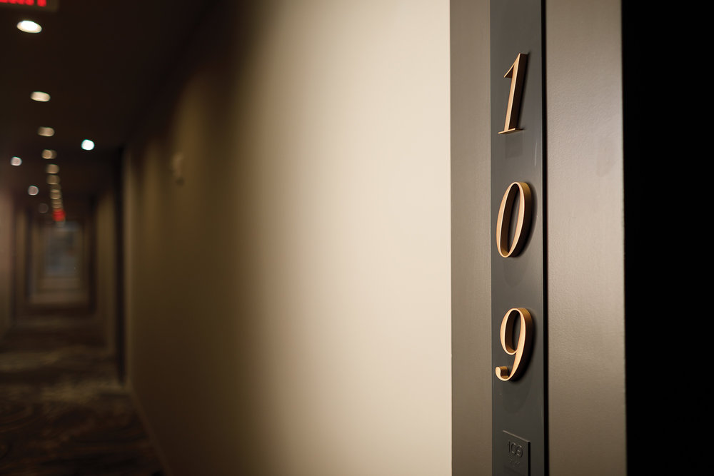 Custom residence signage: ADA compliant with braille and tactile numerals