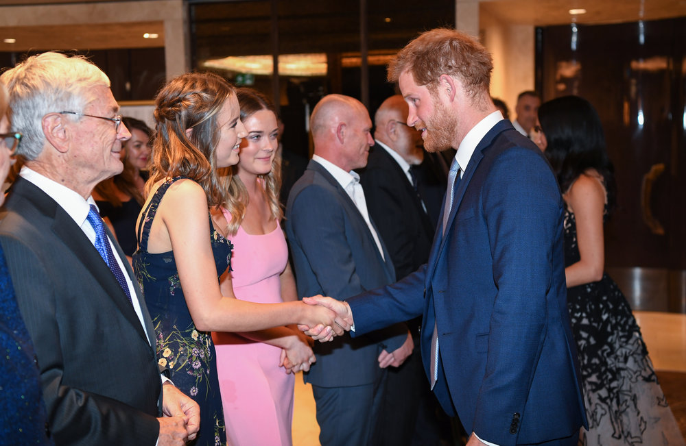Sophia receiving a handshake from the Duke of Sussex, Prince Harry