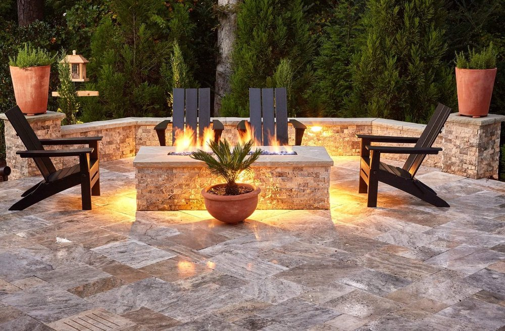 Expand your pool deck to include a Travertine seat wall built around a modern family fire feature with reflective fire glass $15 feature