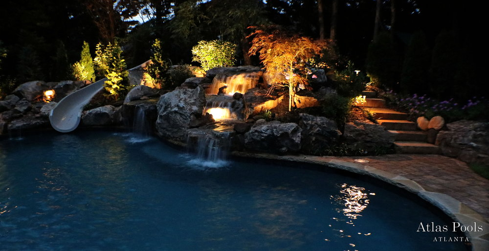 Disney waterfall w 10 tons of Tennessee boulders. Stone steps lead to a hidden bridge over the waterfall to the slide. Landscape and lighting. $40 feature