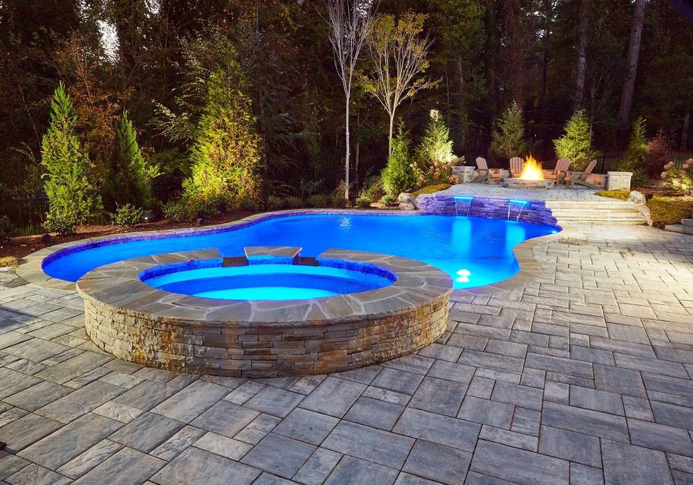 Raised spa with 2 spillovers. Fire seating area. Sheer waterfalls. Landscape. Lighting. Paver decking $100