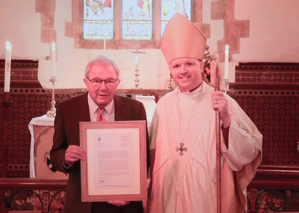 Bishop Graham presenting Mike with his letter of thanks