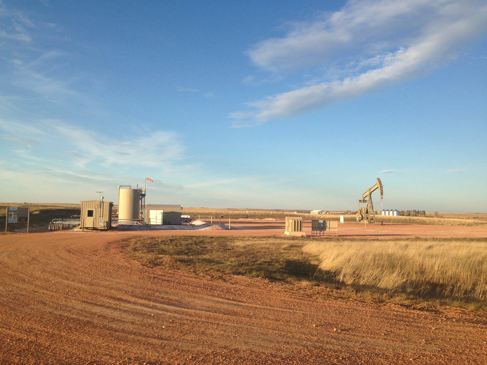Oil and gas infrastructure at sunset, McKenzie County