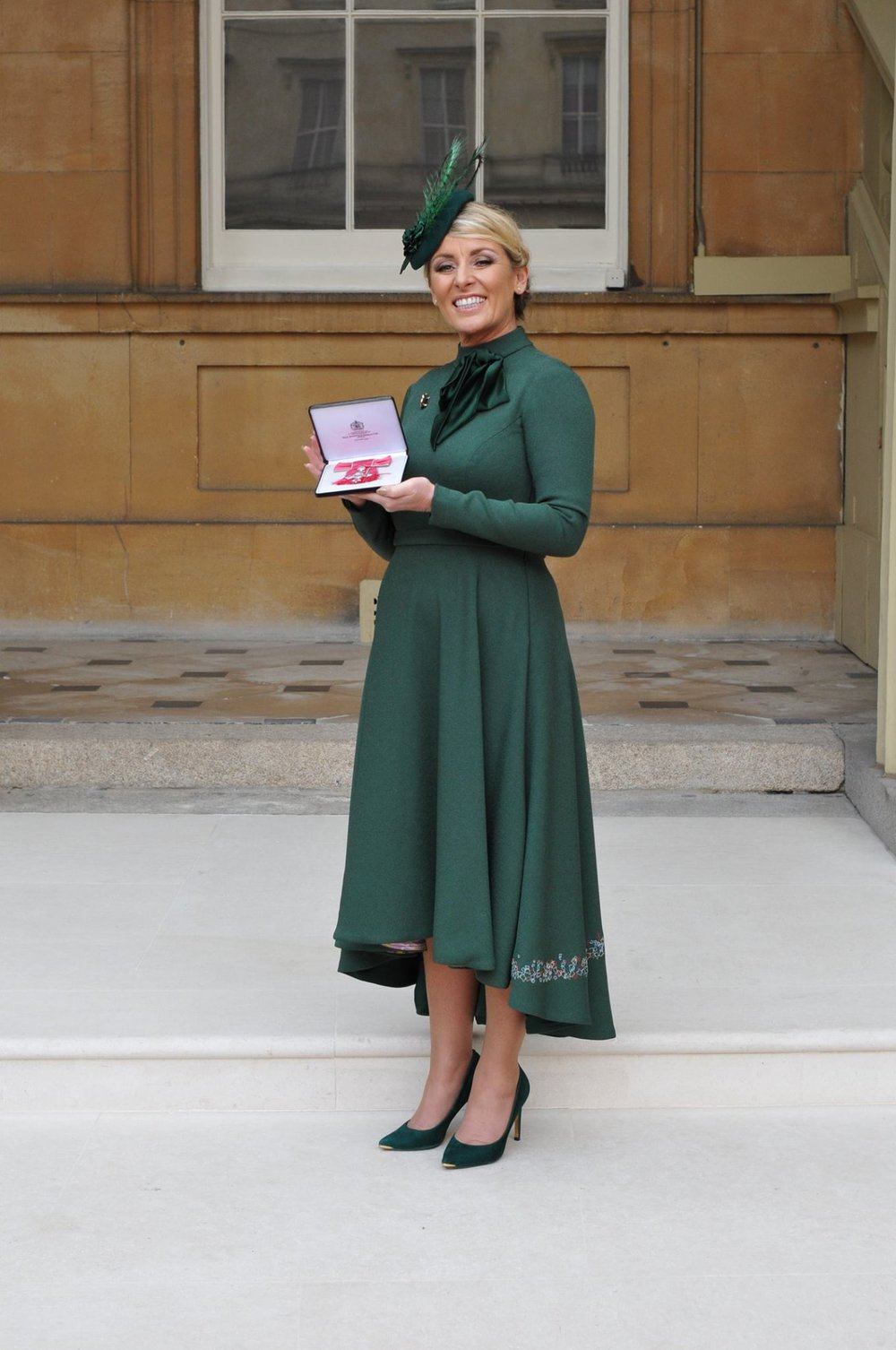 Simone Roche MBE, CEO of Northern Power Women receiving her MBE at Buckingham Palace for services to Gender Equality