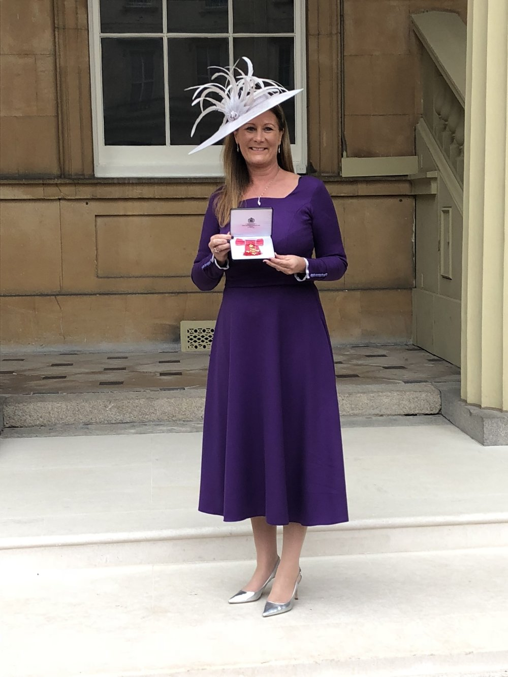 Marnie MIllard OBE, CEO of Nichols PLC receiving her OBE at Buckingham Palace for services to business in the North West and International Trade.